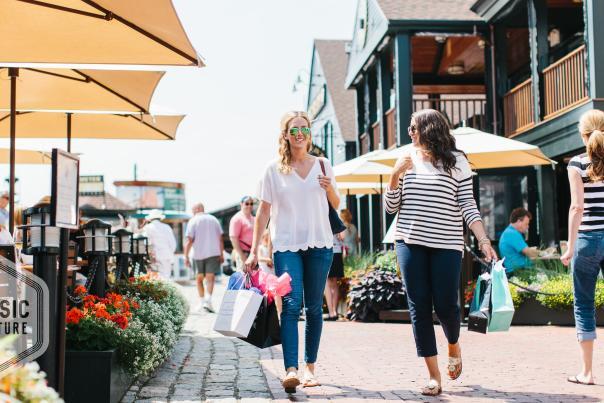 Women carrying shopping bags at Bowen's Wharf in Newport Rhode Island