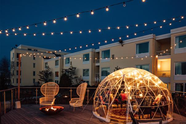 Deck with a lit up igloo in the evening at Gurney's in Newport RI