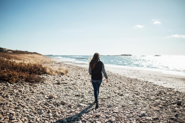 Person walking along the beach in Little Compton, Rhode Island