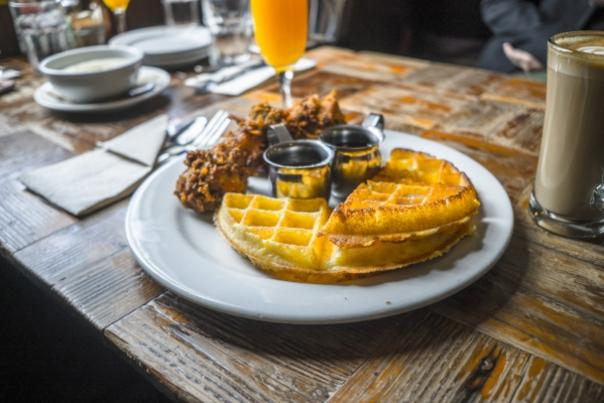 A table plated with breakfast waffles from Brown Sugar Kitchen in Oakland, CA