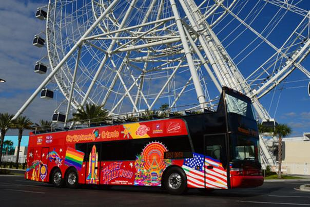 City Sightseeing tour bus in front of the Coca-Cola Orlando Eye