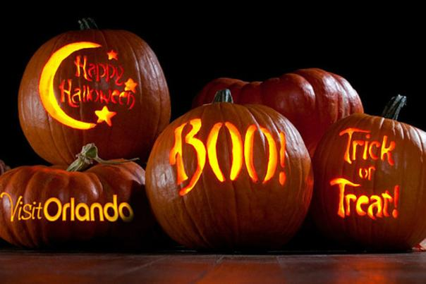 Pumpkins with Visit Orlando logo, Happy Halloween, Boo and Trick or Treat carved on them