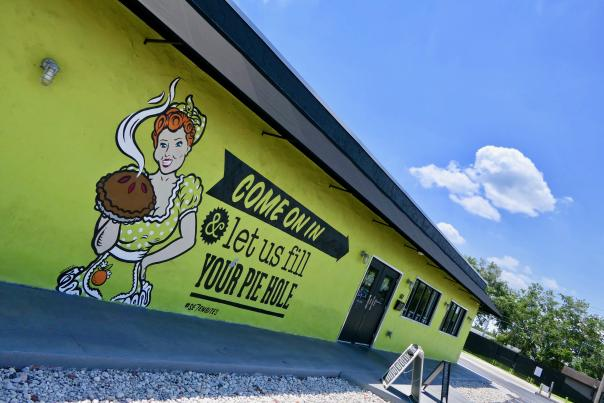 A mural on the exterior of Se7en Bites, located in Orlando's Milk District.