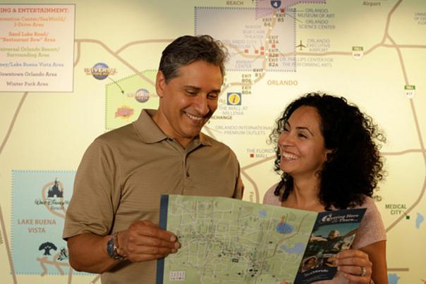 Couple in front of a map at the visitor center