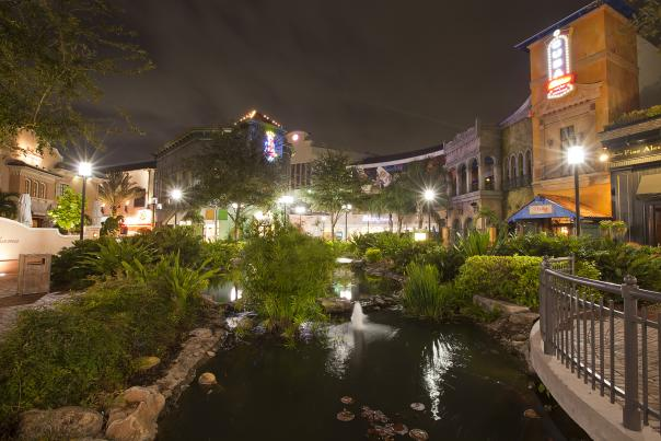 night shot of shops and restaurants on International Drive