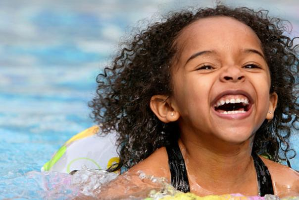 little girl swimming in a pool