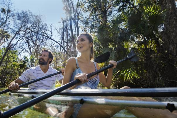 A couple kayaking through King's Landing at Wekiva River