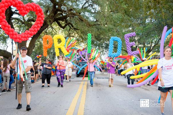 Come Out With Pride parade with pride balloons