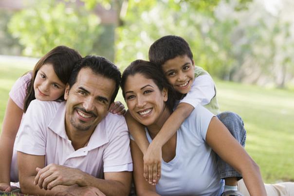 A hispanic family enjoying a picnic