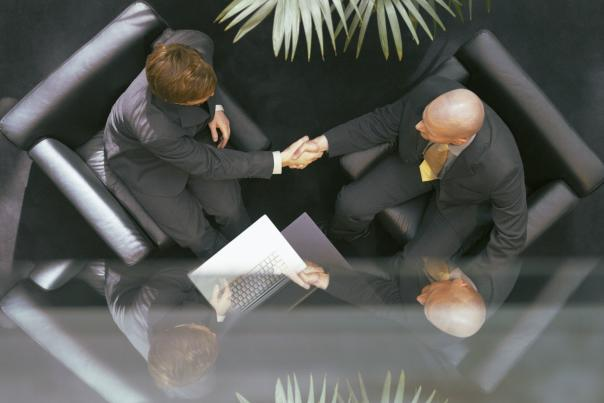 A birds-eye view of business people meeting in a lobby