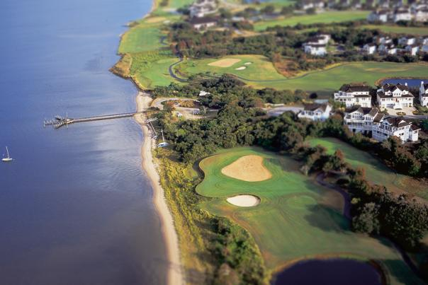 Aerial view of a golf course along the coast in the Outer Banks