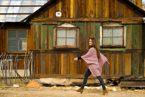 Woman walking through Keys Ranch in Joshua Tree