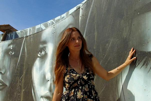 Woman viewing a black and white mural.