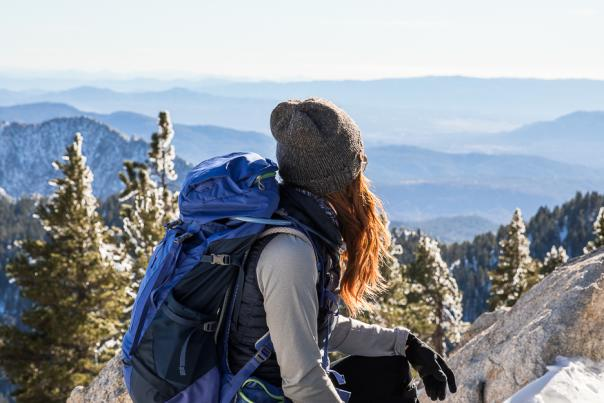 Female hiker admiring the snowy view from San Jacinto Peak