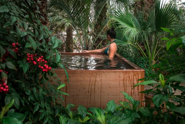 Woman relaxing in hot mineral pool at Two Bunch Palms resort in Desert Hot Springs