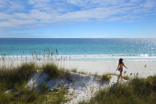Girl on the beach sand dune