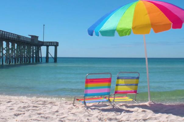 Rainbow umbrella and beach chairs