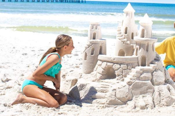 Kids with sandcastle