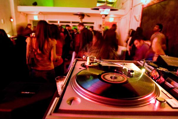 A vinyl record spins at Bar Smith