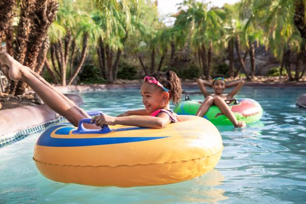 Kids in the Lazy River at Hilton Phoenix Resort at the Peak