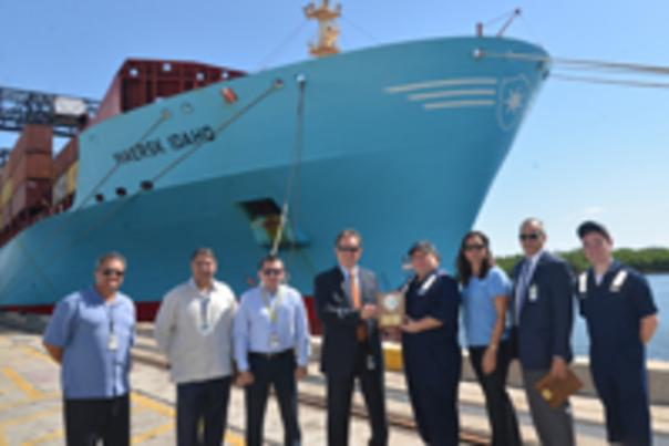 Photo of port and shipping officials.