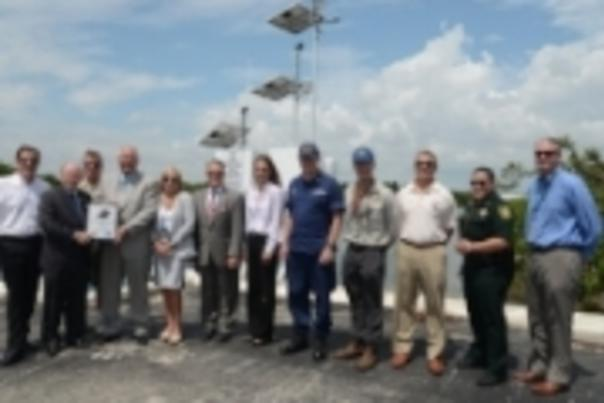 Celebrating the installation of the Port Everglades Physical Oceanographic Real-Time System.