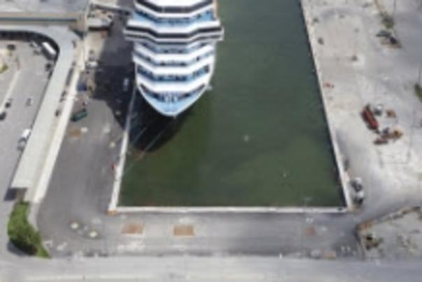 Aerial view of the slip 2 extension with a cruise ship tied up at the dock.