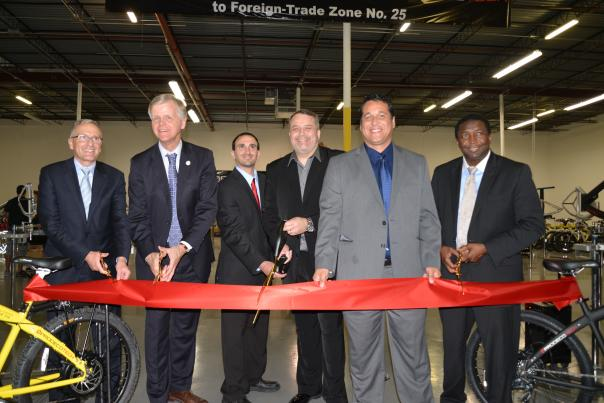 Image of Port, County and Prodeco Tech officials at the ribbon-cutting ceremony for Prodeco Tech's grand opening.