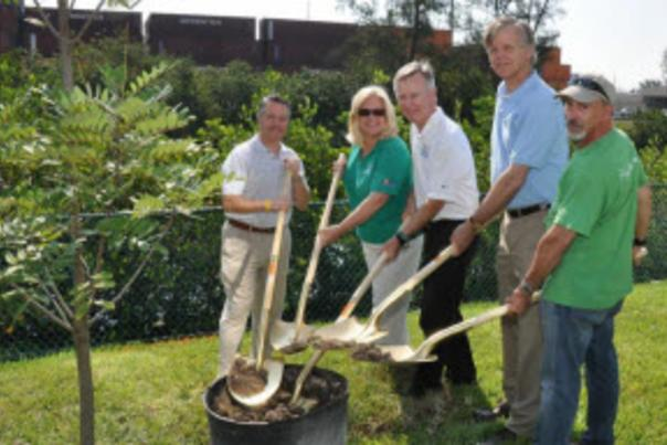 Image of Port, County and community leaders planting a tree.