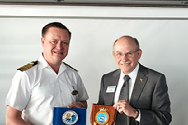 Acting Chief Executive & Port Director Glenn Wiltshire (right) and Sky Princess Captain Heikki Laakkonen exchange plaques aboard the Sky Princess.