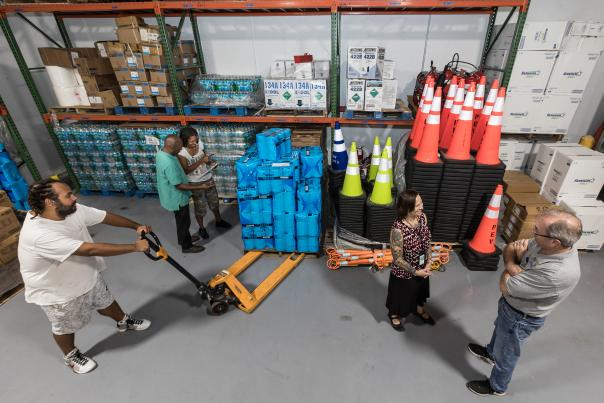 Staff conducts inventory control in upgraded Port warehouse.