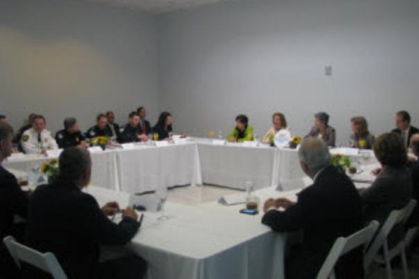 Image of port and Department of Homeland Security officials at a table talking.