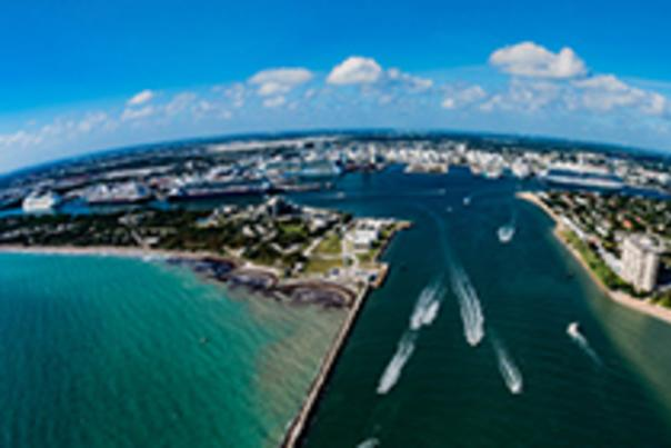 Port Everglades entrance channel with seven cruise ships at dock.