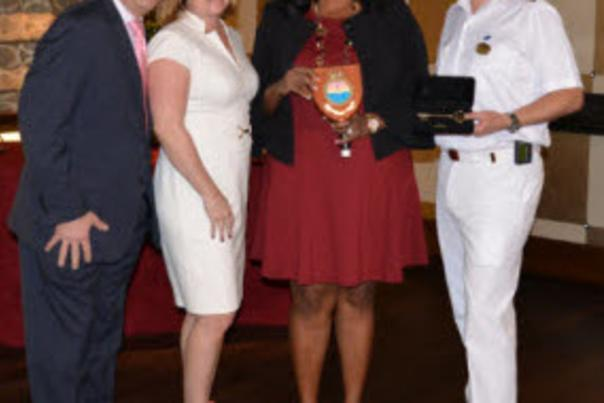 Image of County and Princess Cruise officials in a plaque exchange.