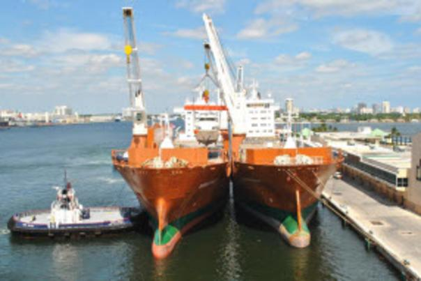 Image of yacht be loaded onto a larger vessel for transport