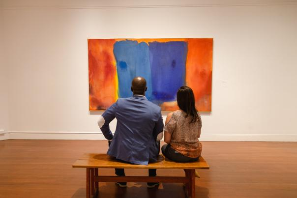 Visitors contemplate a painting on display at the RISD Museum in Providence Rhode Island