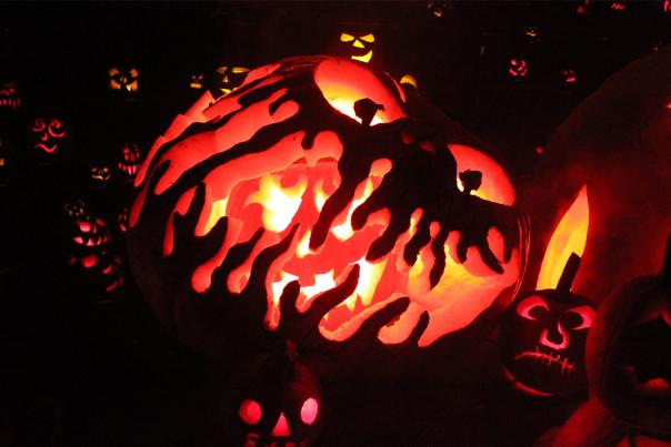 Large big-mouthed Jack-o-lantern surrounded by smaller jack-o-lanterns