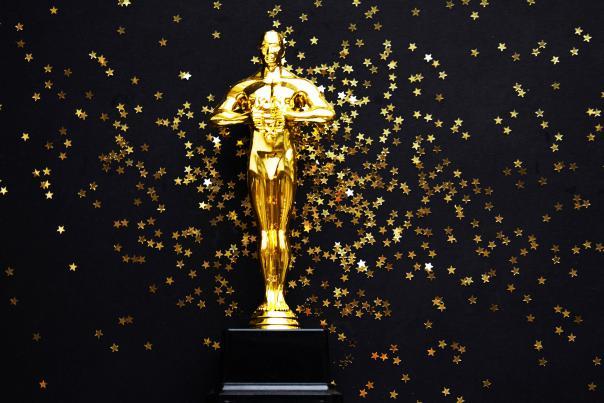 Oscar gold statue trophy on a black background