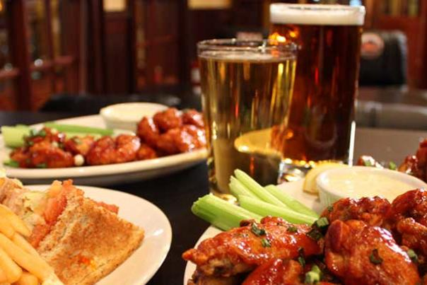 Spread of Wings, Fries and Beer at Wicked Good Bar & Grill