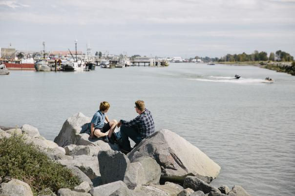 A man and a boy looking out over the water at Steveston Village