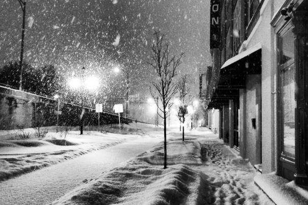 Showing a beautiful snowy evening in the city