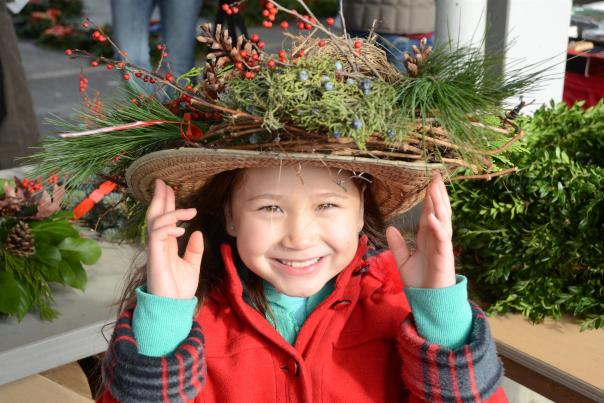 kid with holiday hat at public market