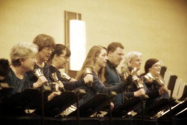 7 handbell musicians performing