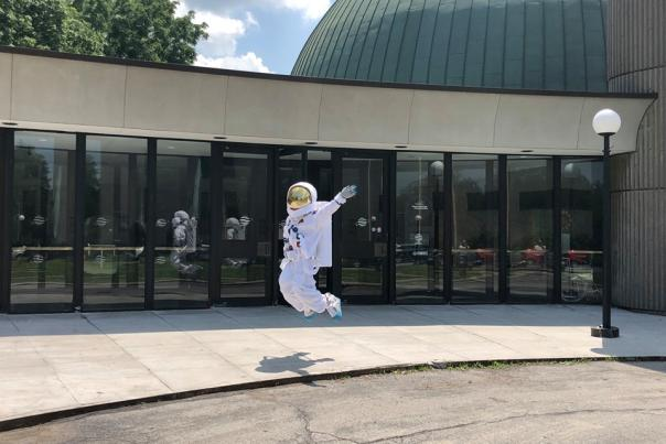 Astronaut Jumps in Front of Planetarium at Rochester Museum & Science Center
