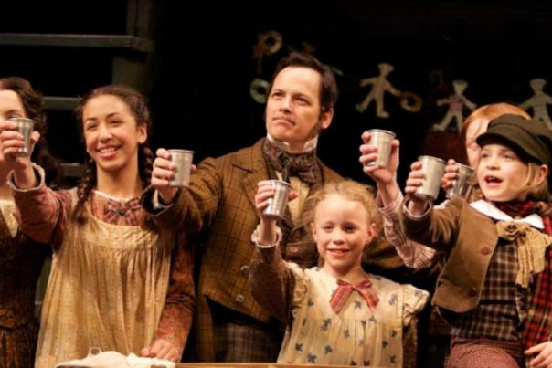 Stage actors toast during performance of a Christmas Carol at Geva Theatre