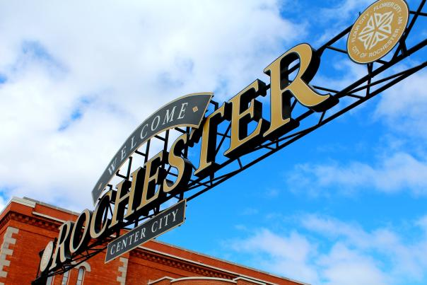 Dramatic angle on welcome to Rochester sign.
