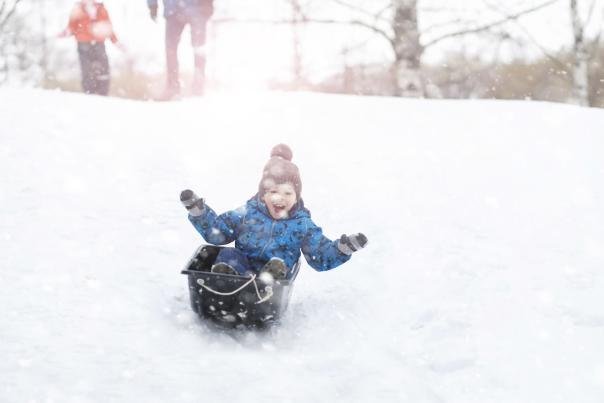 Boy sledding at Diamond Lake Resort