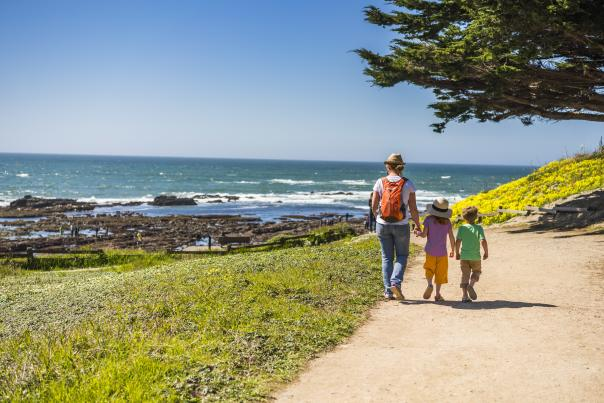 Family walking the trail at Fitzgerald Marine Reserve in San Mateo County.
