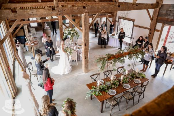 People viewing the inside of the barn
