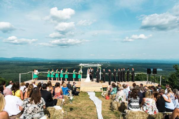 West Mtn. wedding performed at peak, with wedding party and spectators with beautiful view